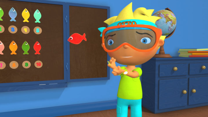 Picture of Otto letting the fish go after he bit his finger