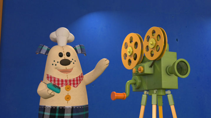 Picture of Huggy geting ready to show the children the movie of Jack Sprat