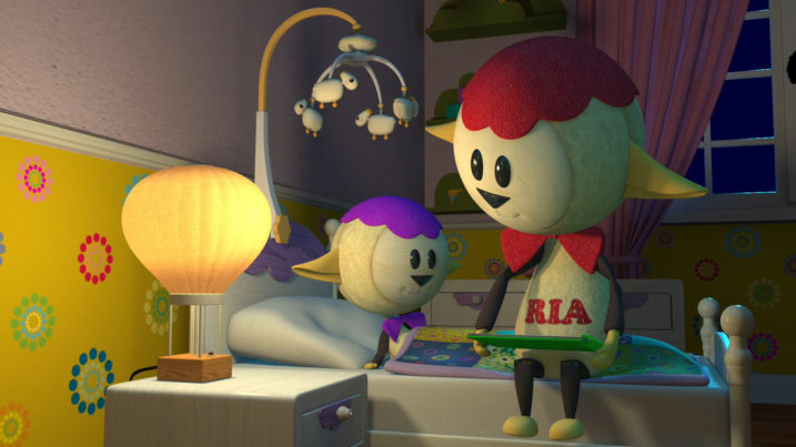 Picture of Ria reading to her son Barney