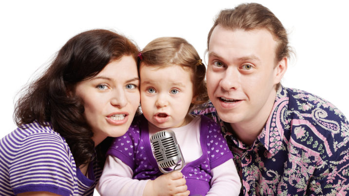 Picture of mother, father and child singing